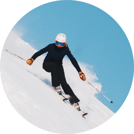 A person on a slope on skis.