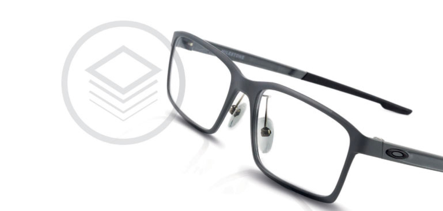 A pair of thin, black Oakley glasses.