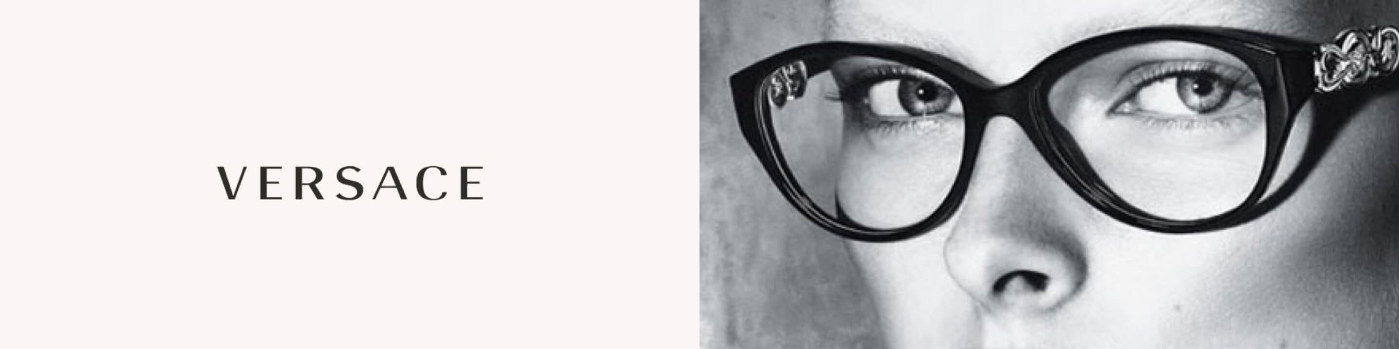 Close-up black and white image of a young woman wearing a pair of large black Versace glasses.