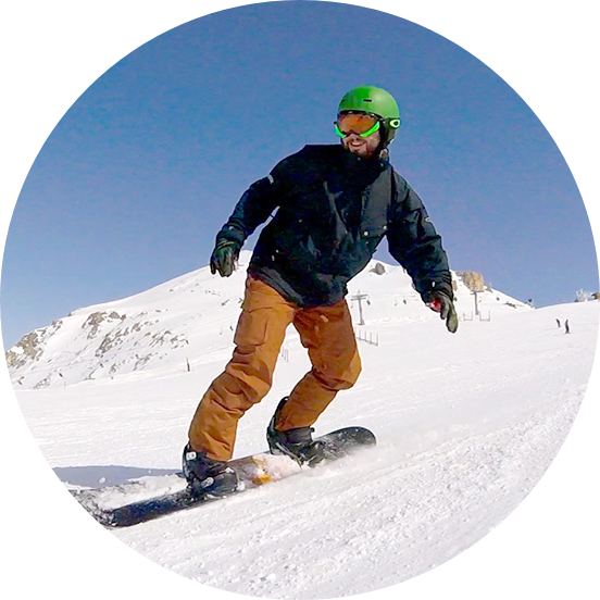 A person on a snowboard on snow.